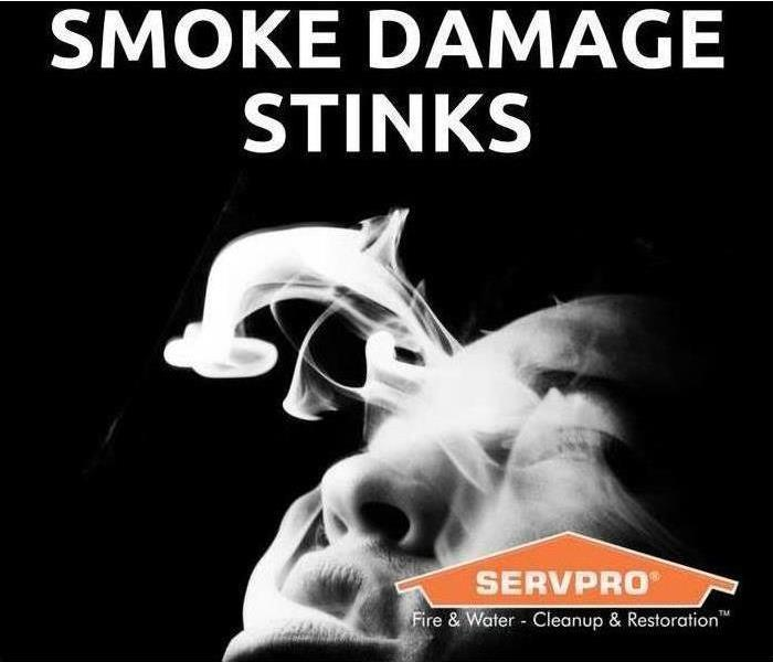 Smoke with a sign that says SMOKE DAMAGE STINKS