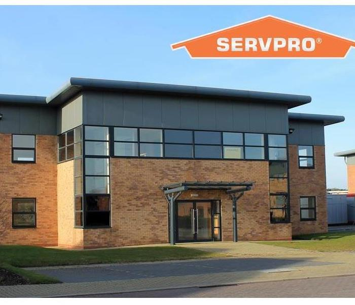 Exterior of empty modern office building with orange SERVPRO logo